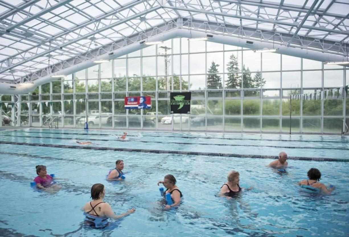 Swimmers participate in a deep-water fitness class at the Clark County Family YMCA in Vancouver. It's the only full YMCA in the county, but groups in Ridgefield, Woodland and Battle Ground have all started the process to bring in YMCAs, and a group in east county has had preliminary discussions on looking into it.