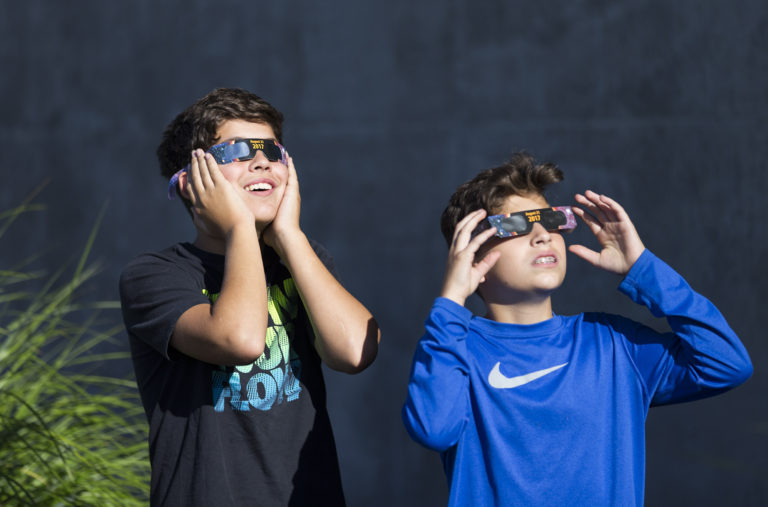Braden Miller, 14, left, and Jonah Miller, 13, from Vancouver, watch the solar eclipse from Vancouver Community Library in Vancouver on Monday morning, Aug. 21, 2017. The last total solar eclipse that was viewable from the United States was in February 26, 1979.