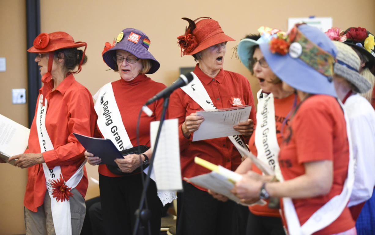 The Portland Raging Grannies, a social activist group, sing their testimony against the Vancouver Energy oil terminal at an Energy Facility Site Evaluation Council hearing Tuesday at Clark College at Columbia Tech Center.
