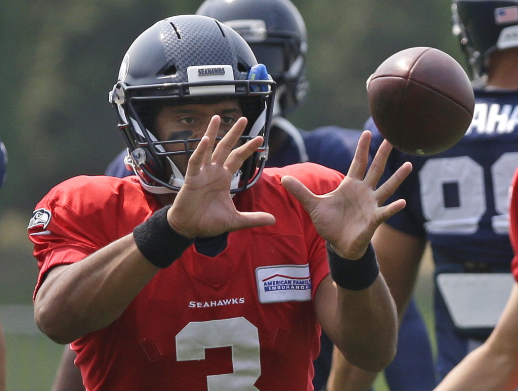 9cff63237b5 Seattle Seahawks quarterback Russell Wilson catches a ball during warmups  before an NFL football tra