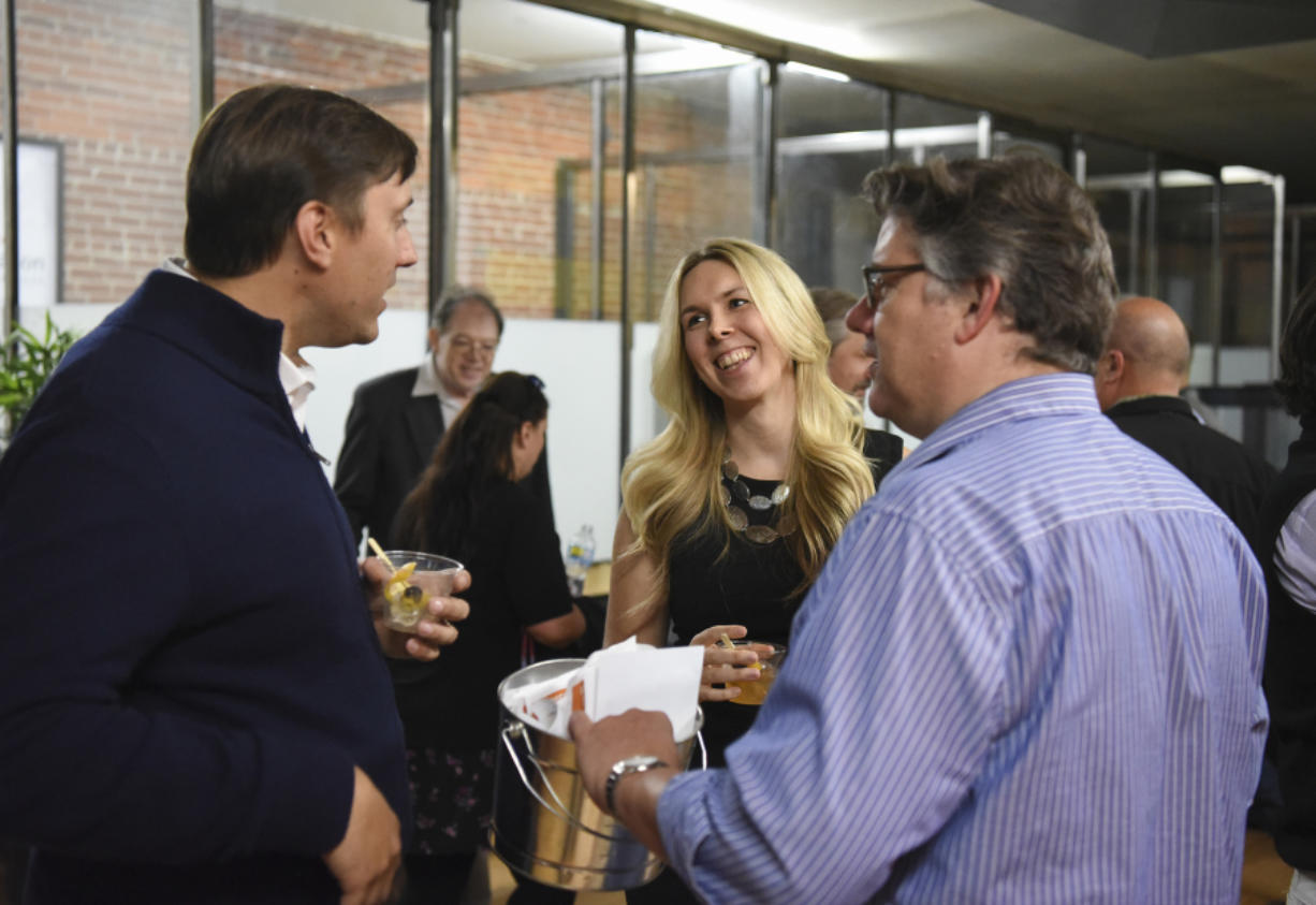 Alexis Bafford of Empyrean Trust, center, talks to Eric Preisz of Graham Software Investments, left, and Dave Barcos of The Bridge Incubator, during Vancouver Tech Tours on Tuesday. All three are helping organize new community events aimed at building a tighter-knit tech community in Vancouver.