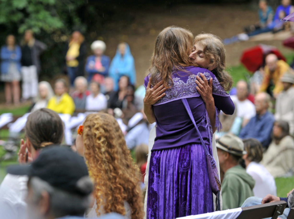 Asha Deliverance, the mother of Taliesin Myrddin Namkai-Meche, accepts a hug during a celebration of her son's life in Lithia Park in Ashland, Ore., on June 7. (The Register-Guard)