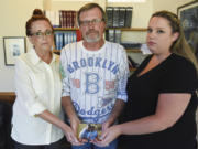 Mycheal Lynch's stepmother Lila Fields, father Kim Lynch and sister Kelly Foster hold a photo of Mycheal with his niece. Mycheal Lynch was 32 in March 2015 when he died after a struggle in the Clark County Jail. Since his death, Lynch's family has been working with attorneys Jack Green and Greg Ferguson to find answers and seek justice for their loved one.