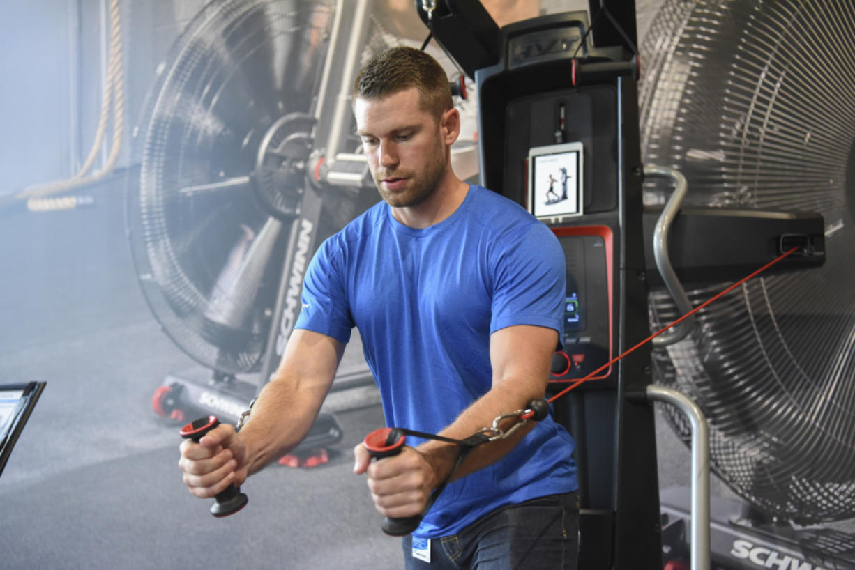 Gabriel Baker, a retail project manager at Nautilus Inc., demonstrates the Bowflex Hybrid Velocity Trainer at its Innovation Center in Vancouver. The company says new product innovation will be its foundation.