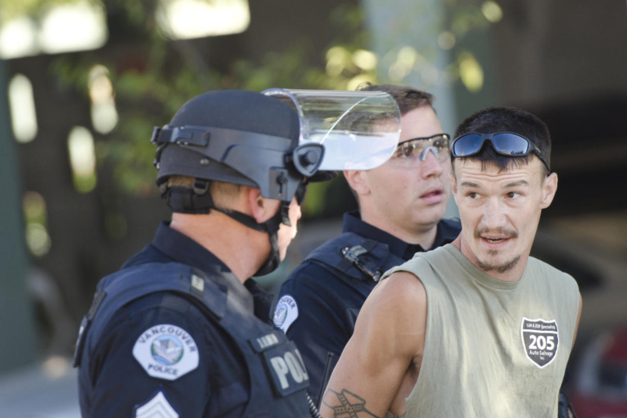 A man was detained and released after nearly driving over counterprotesters after a rally held by Joey Gibson's Patriot Prayer group. (Samuel Wilson for the Columbian)