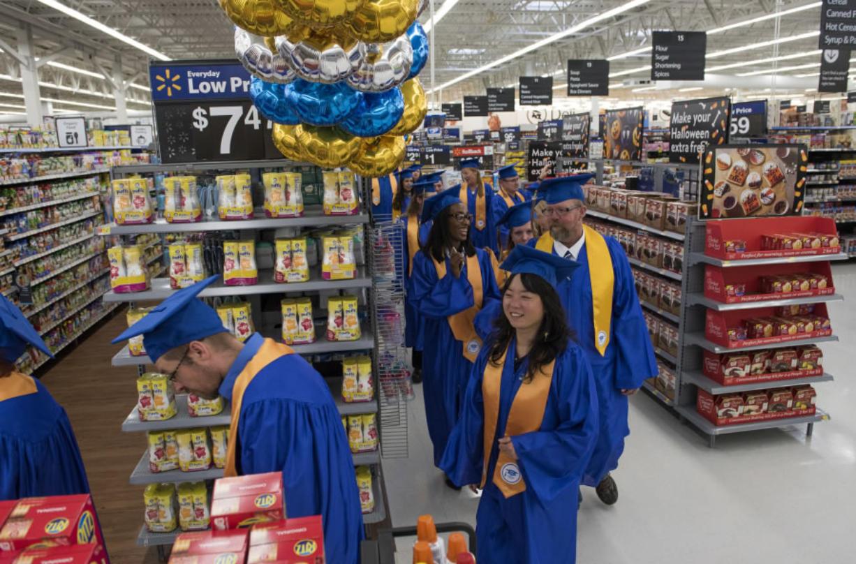 Wal-Mart Academy fetes first local grads - Columbian com