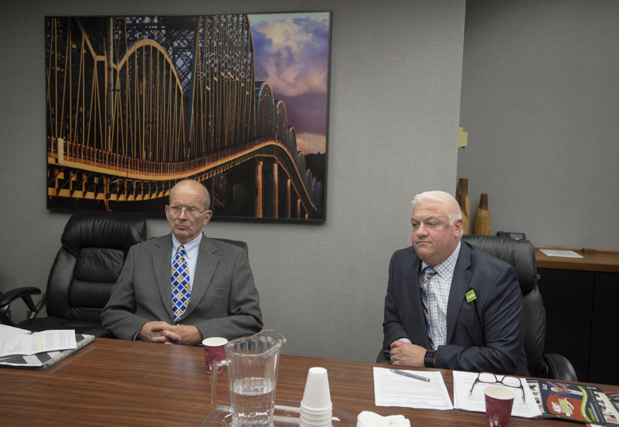 Don Orange, left, and Kris Greene, both candidates for Port of Vancouver commissioner, District 1, take questions from the Editorial Board at The Columbian on Friday morning.