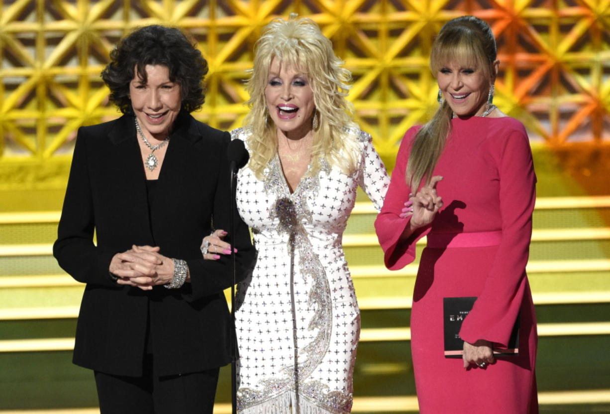 Lily Tomlin, from left, Dolly Parton and Jane Fonda present the award for outstanding supporting actor in a limited series or a movie at the 69th Primetime Emmy Awards on Sunday at the Microsoft Theater in Los Angeles.