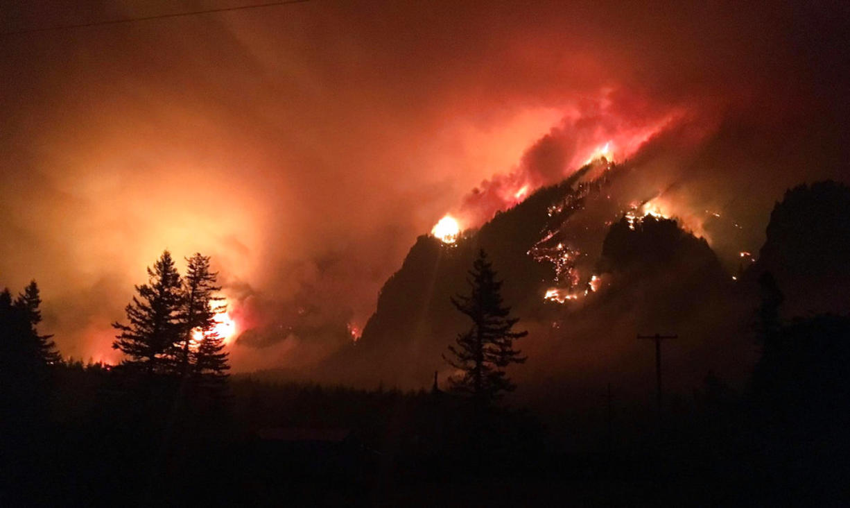 This Sept. 4, 2017, photo provided by Inciweb shows the Eagle Creek wildfire burning in the Columbia River Gorge east of Portland, Ore. A lengthy stretch of highway Interstate 84 remains closed Tuesday, Sept. 5, 2017, as crews battle the growing Eagle Creek wildfire that has also caused evacuations and sparked blazes across the Columbia River in Washington state.