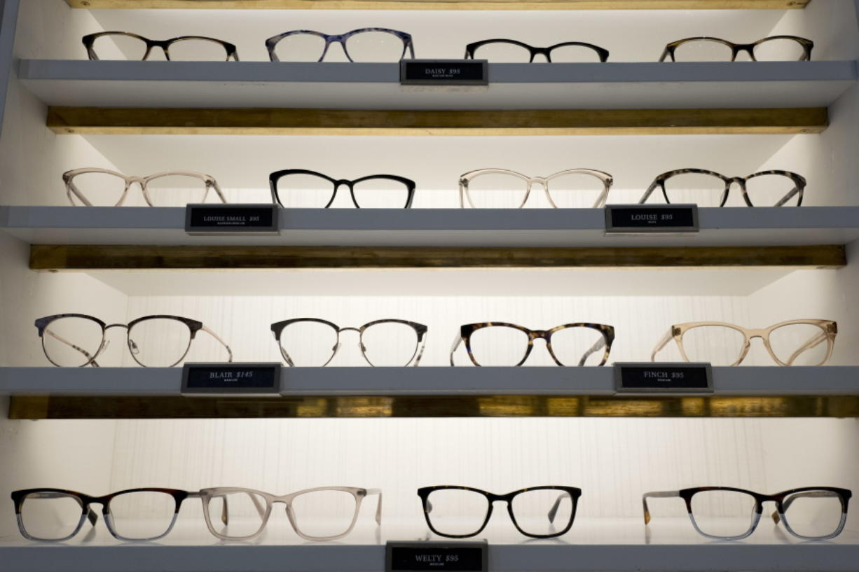 Warby Parker eyewear is displayed at a company retail store Wednesday in New York. At Warby Parker, you can pick out five frames to try for five days for free.