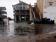 Floodwaters surround homes as Hurricane Maria moves closer to North Carolina's Outer Banks on Tuesday. Thousands of visitors abandoned their vacation plans and left the area as the hurricane moved northward in the Atlantic, churning up surf and possible flooding.