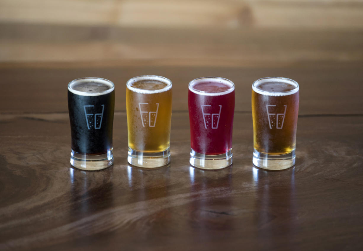 The Pauly Schwarz by 54º40' Brewing, left, the Flat Track Blonde by Loowit Brewing, the Rowing Needles by Modern Times and Oktoberfest by Mazama Brewing are pictured at Final Draft Taphouse in Vancouver on Sept. 26, 2017.