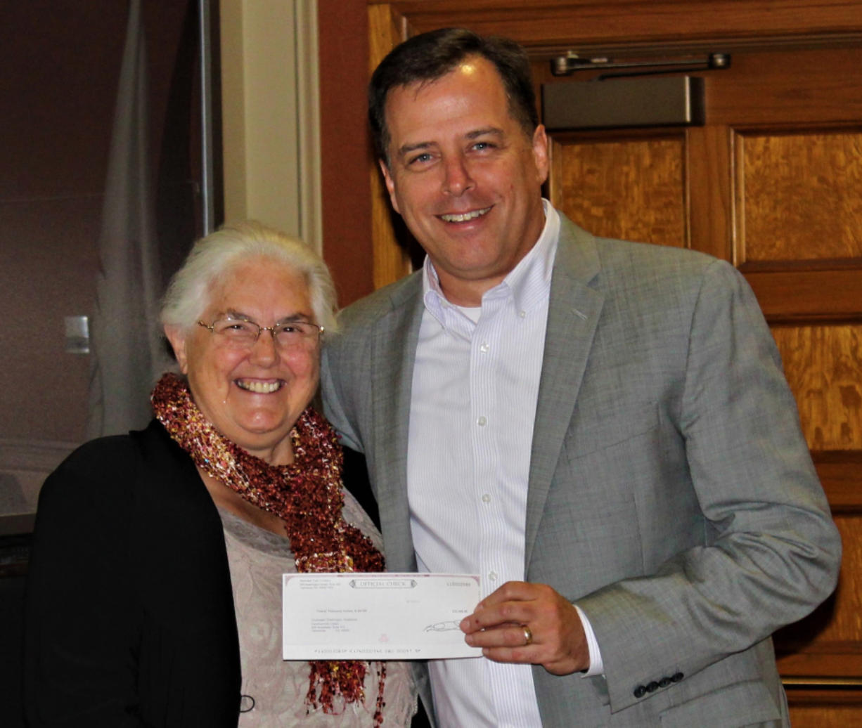 Honorable Frank L. and Arlene G. Price Foundation Executive Director Kay Dalke-Sheadle, left, presents a check for $20,000 to John Vanderkin, Workforce Southwest Washington board chairman, to help fund a Kelso youth workforce training program.