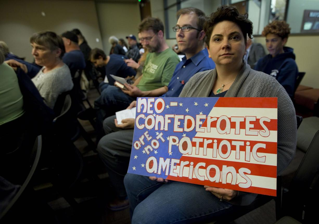 Danielle Jokela attends a county historic preservation hearing at City Hall in Vancouver Tuesday. The hearing was held to determine the fate of the Jefferson Davis Highway marker;s place in the historical registry. (Photo by Natalie Behring/ for The Columbian)