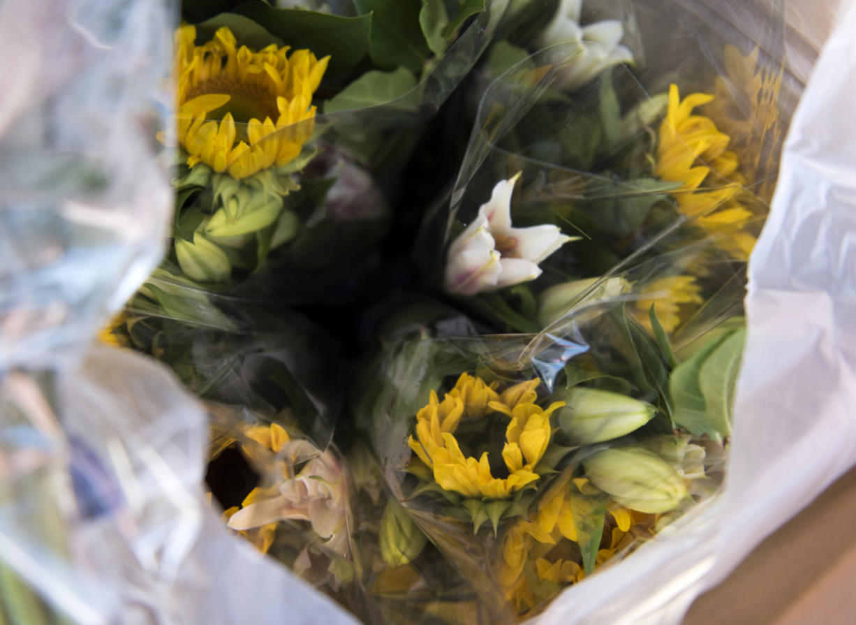 Holland America Flowers handed out 200 bouquets in Woodland and Battle Ground on Wednesday afternoon for Society of American Florists' national event, Petal it Forward. (Alisha Jucevic/The Columbian)