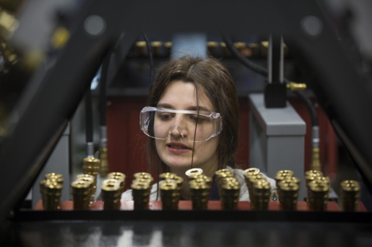 Dana Mals reacts as she learns about hydraulics Saturday in the lab at the Columbia Tech Center in Vancouver. Mals is enrolled in the college's new Rural Access Mechatronics Program, a hybrid class for students who live in rural parts of Southwest Washington.