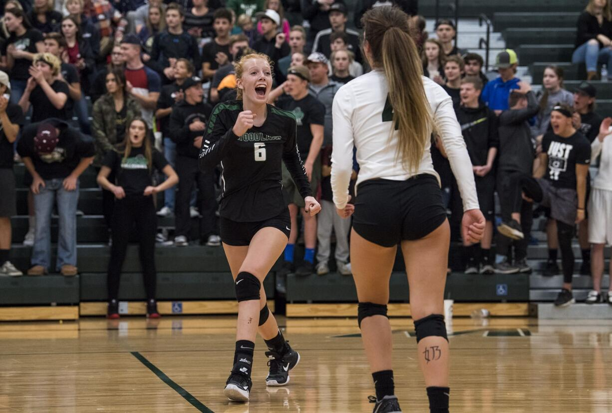 Woodland's Emma Swett (6) celebrates a point during the match at Woodland High School on Tuesday evening, Oct. 17, 2017. Woodland won the match 3-1.