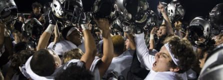 Union celebrates their victory over Camas after Friday night's rivalry game at Doc Harris Stadium in Camas. The win snapped a 58-game regular season win streak for Camas.