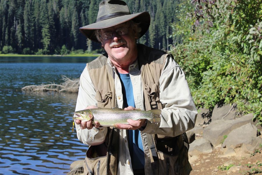The author holds a chunky Goose Lake cutthroat trout. The lake s cutthroats  draw anglers to be7371734c41