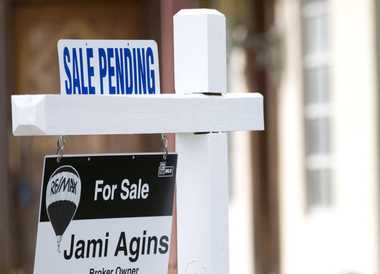 """FILE - In this Thursday, Jan. 8, 2015, file photo, a """"Sale Pending"""" sign sits atop a realty sign outside a home for sale in Surfside, Fla. The National Association of Realtors releases its September 2017 report on pending home sales on Thursday, Oct. 26, 2017. (AP Photo/Wilfredo Lee, File)"""