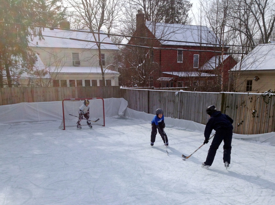 Members Of The Rubin Family Play Hockey On Their Backyard Ice Rink In The  Burns Park