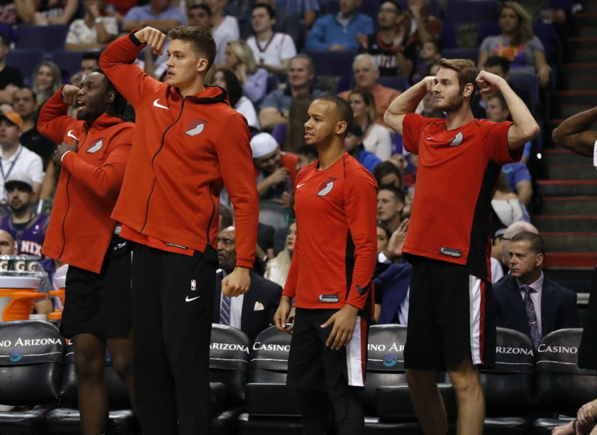 Players on the Portland Trail Blazers bench celebrate during the second half of the team's NBA basketball game against the Phoenix Suns, Wednesday, Oct. 18, 2017, in Phoenix.