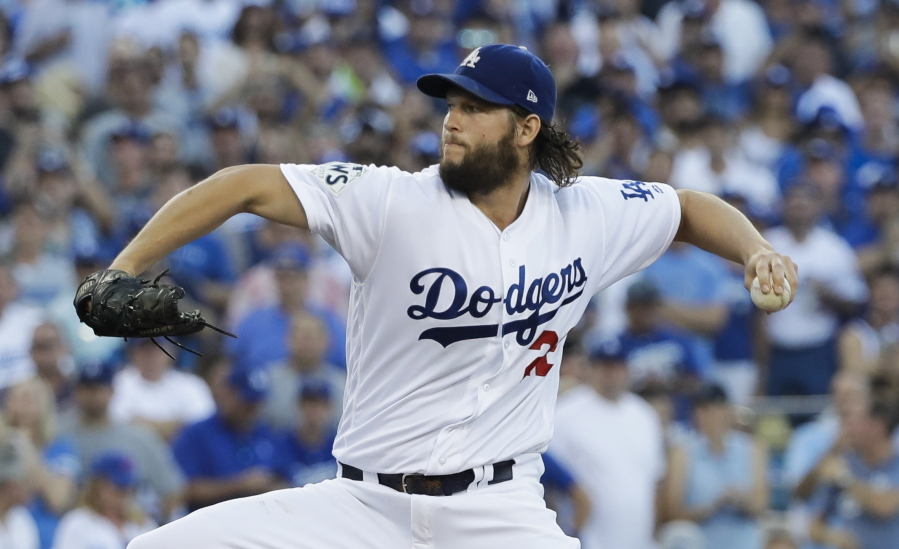 Los Angeles Dodgers starting pitcher Clayton Kershaw throws during the first inning of Game 1 of baseball\u0027s World Series against the Houston Astros Tuesday ... & Kershaw Dodgers beat Astros 3-1 in hot World Series opener | The ...