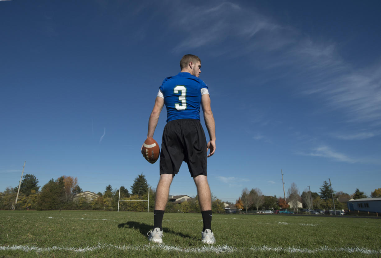 Mountain View High School quarterback Glen Perry Jr. on his team's practice field Tuesday morning. (Amanda Cowan/The Columbian)