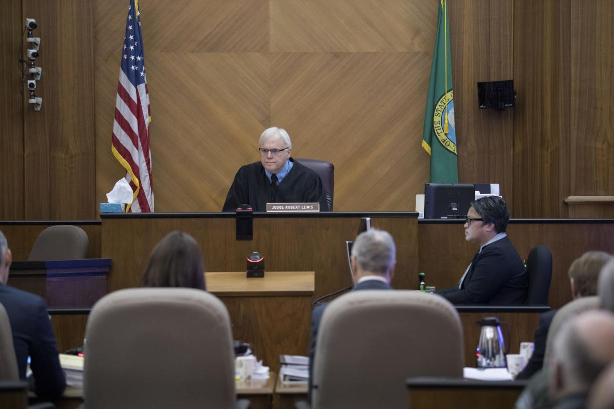 Judge Robert Lewis presides over Brent Luyster's triple aggravated murder trial in Clark County Superior Court on Wednesday morning, Nov. 1, 2017.