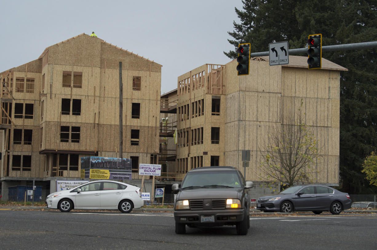 Traffic in Salmon Creek travels past the new 134th Street Lofts on a recent morning. The 124-unit complex is expected to open in April.