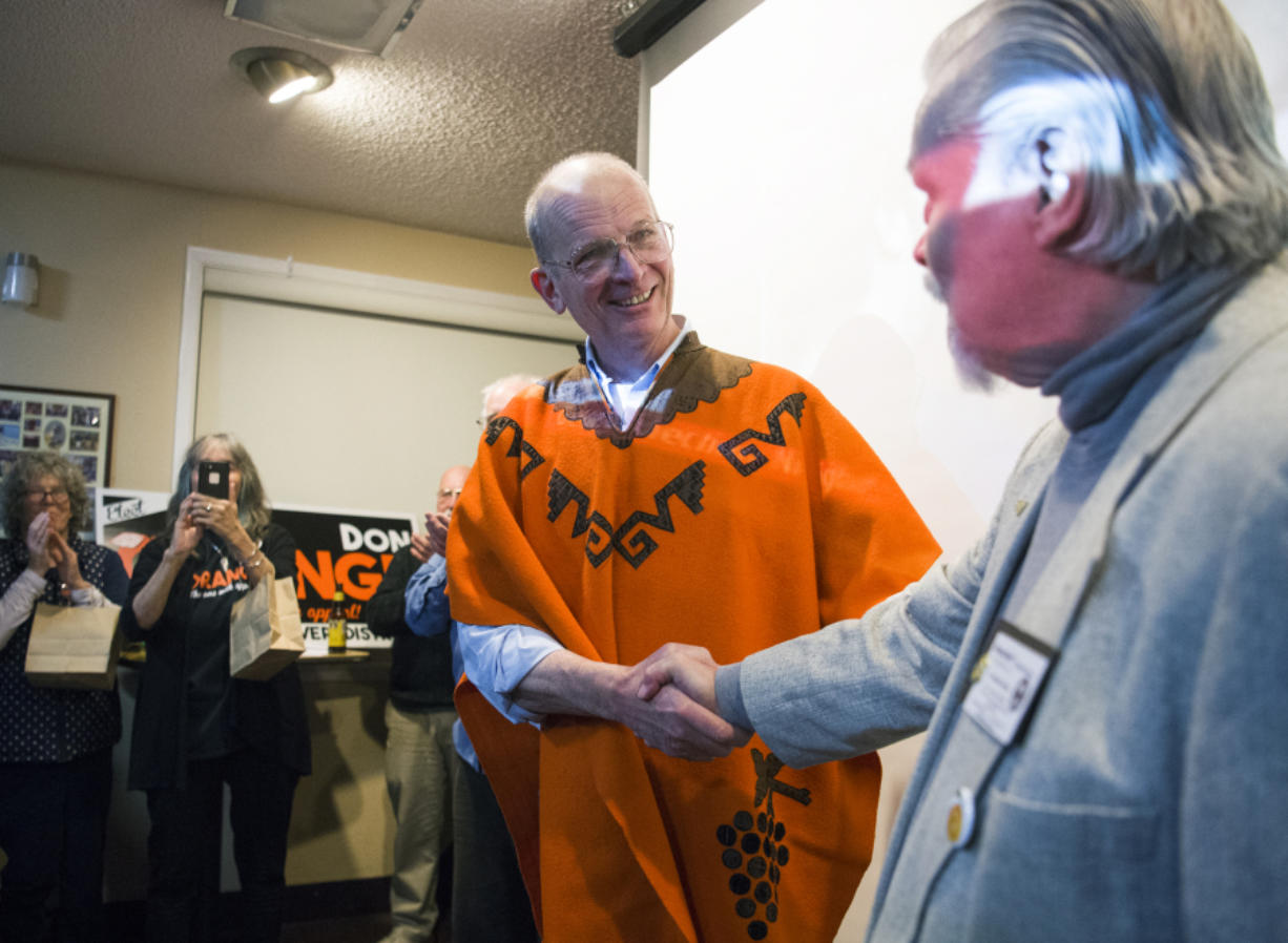 Don Orange shakes hands with Douglas Canoose at the Vancouver Firefighters Local 452 in Fruit Valley while receiving congratulations from a large crowd for leading the race for a seat on the Port of Vancouver Board of Commissioners, against his opponent, Kris Greene.