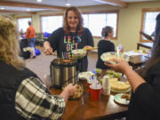 Shannon Livingood of Vancouver, center, dishes herself a bowl of soup during the final meeting of the Taking Back My Life pain management group Tuesday at Battle Ground HealthCare in Meadow Glade. Livingood enrolled in the nine-week program to learn how to manage her chronic pain without medication.
