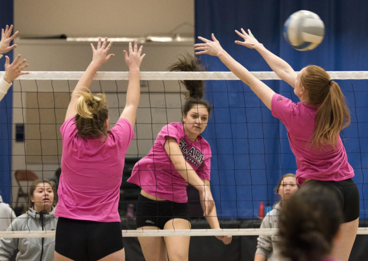 Clark College middle hitter Olivia White, a Skyview High grad, runs through drills during practice Monday at O'Connell Sports Center. The Penguins are preparing for the NWAC Championship tournament that begins Thursday at Tacoma.