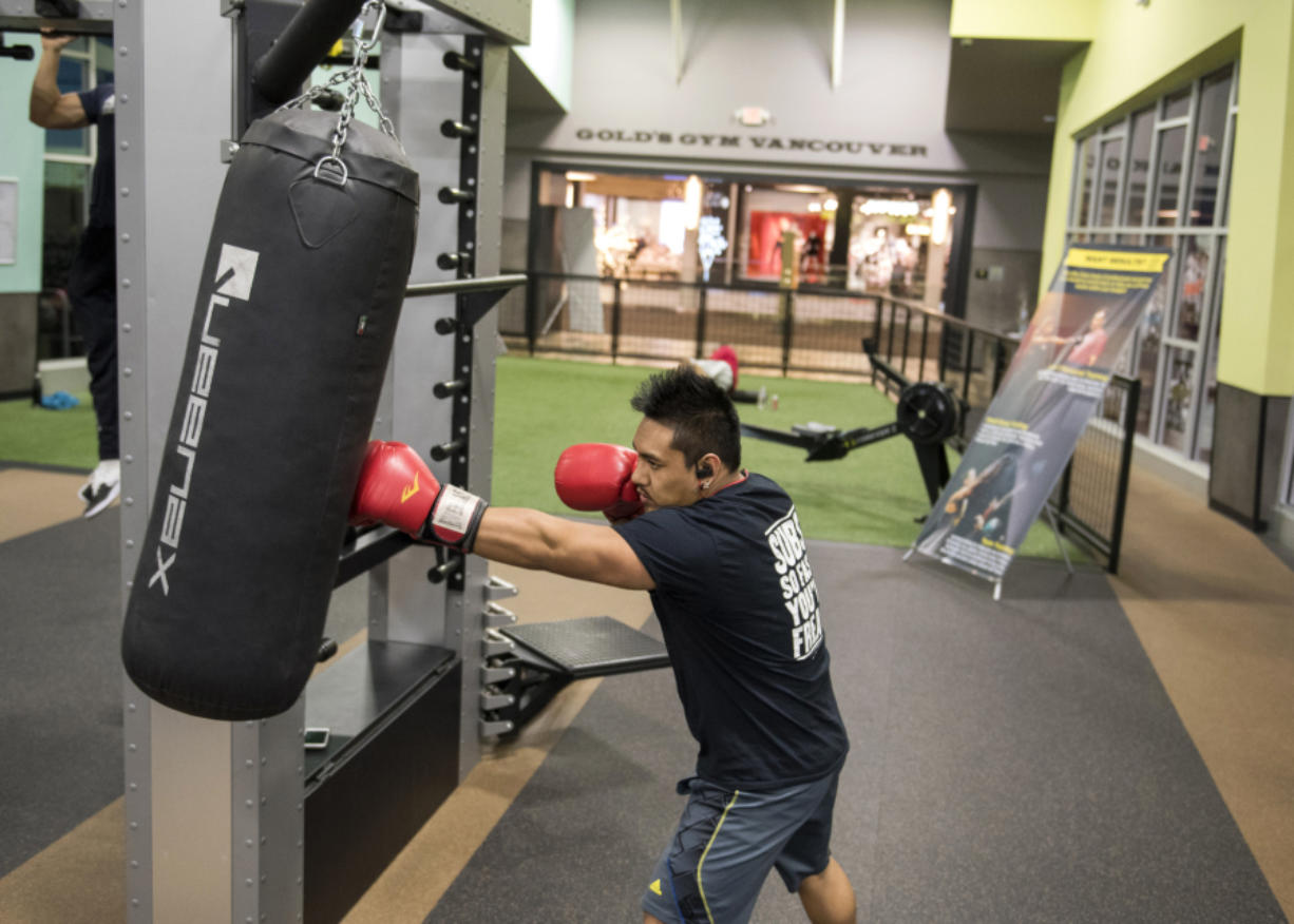 Denzel Bartolaba of Vancouver exercises at Gold's Gym in Vancouver Mall on Monday afternoon. Gold's Gym is one of the new service-style tenants at the mall as it shifts slowly from exclusively apparel to a more well-rounded experience.