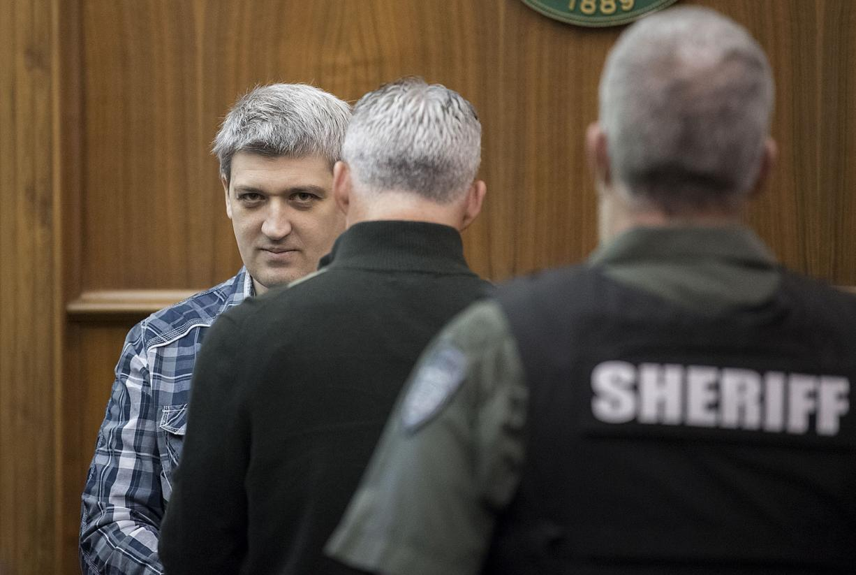 Brent Luyster prepares to be seated during his triple aggravated murder trial in Clark County Superior Court on Monday morning, Nov. 13, 2017.
