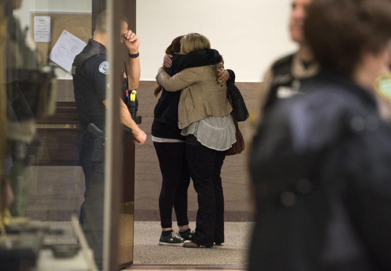 Abia Nunn embraces Heidi Gowing after Brent Luyster was found guilty on all counts in a triple aggravated murder trial in Clark County Superior Court, Friday morning, Nov. 17, 2017. Nunn is the sister of Joseph Mark Lamar, whom Luyster was found guilty of fatally shooting. (Alisha Jucevic/The Columbian)