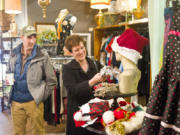 Tom and Alisa Brossia shop at Most Everything Vintage on Saturday in downtown Vancouver to support the Small Business Saturday movement. The campaign, launched in 2010 by American Express, encourages people to shop local the day after Black Friday.