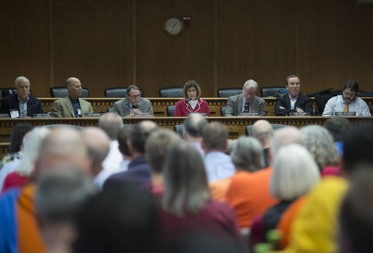 EFSEC chair Roselyn Marcus, center in pink, leads the meeting about the Port of Vancouver oil terminal at the John A. Cherberg Building in Olympia on Tuesday afternoon, Nov. 28, 2017. (Amanda Cowan/The Columbian)