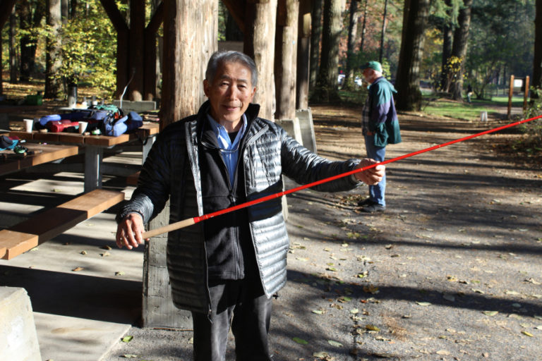 Kuni Masuda, a director with the Clark-Skamania Flyfishers, displays a tenkara fly rod. The ancient Japanese technique uses no reel and is designed for fishing small streams. the rod collapses into a very small package, making it a great choice for backpacking or traveling.