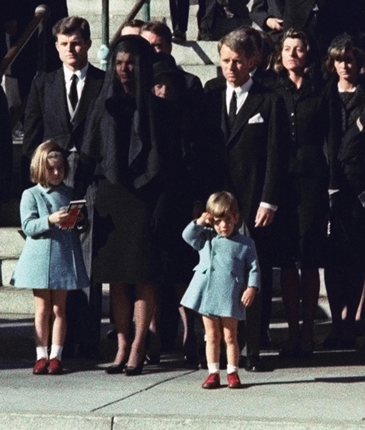 John F. Kennedy Jr., 3, salutes his father's casket Nov. 25, 1963 in Washington, three days after the president was assassinated in Dallas. Widow Jacqueline Kennedy, center, and daughter Caroline Kennedy are accompanied by the late president's brothers Sen. Edward Kennedy, left, and Attorney General Robert Kennedy.