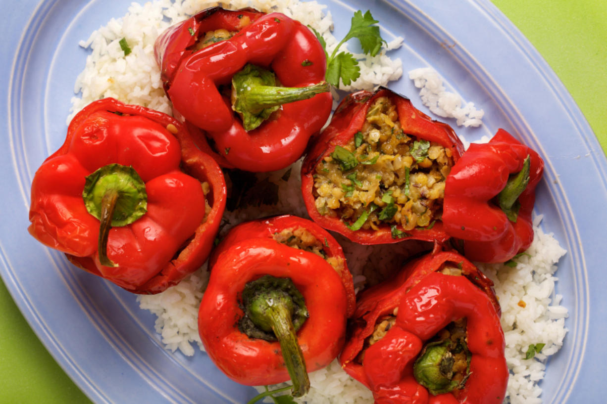 Lentil-Stuffed Bell Peppers. (Deb Lindsey for The Washington Post)