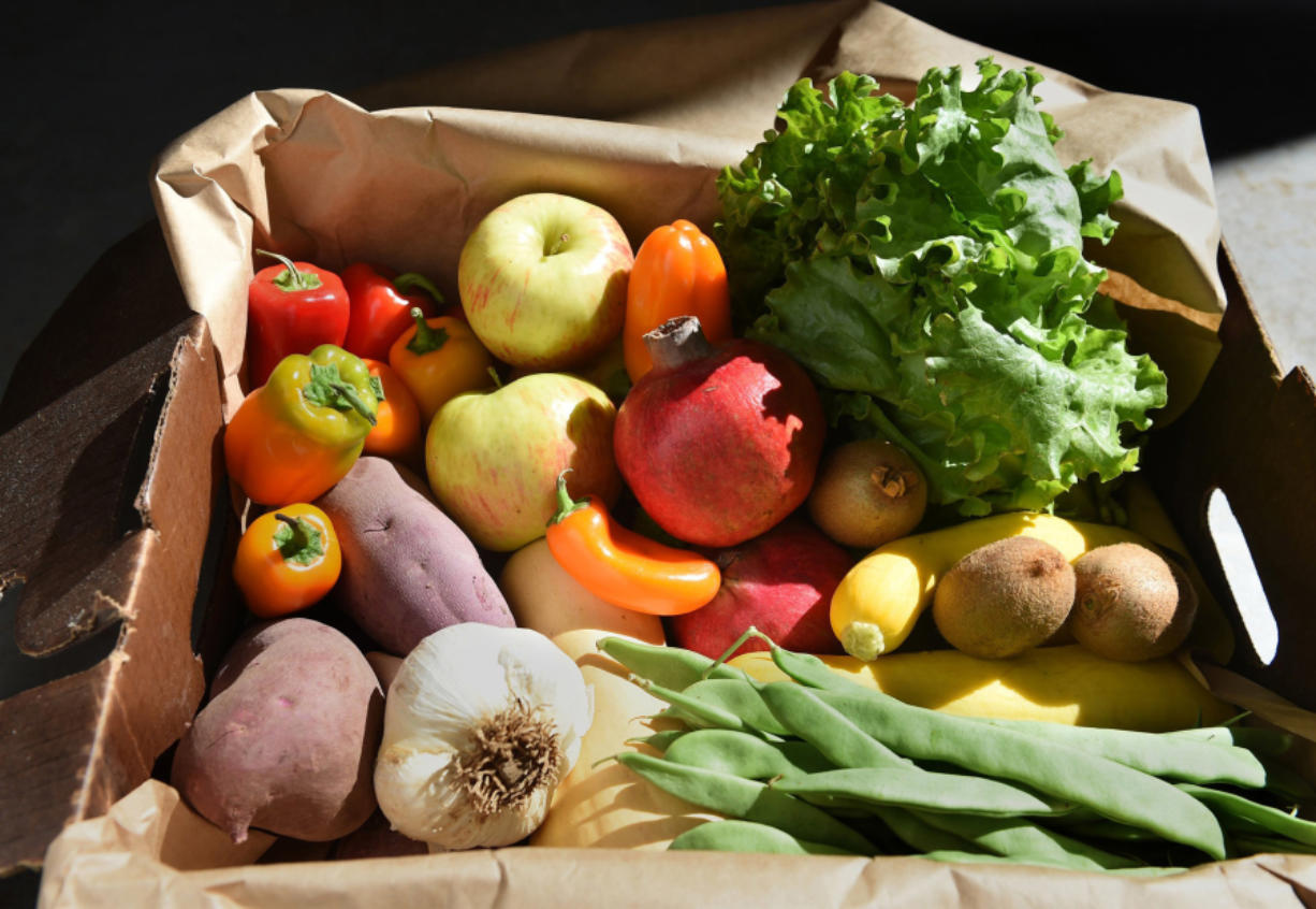 A box of produce from Harvest Fields Organic Farm. If we slashed food waste and raising livestock and eating meat, organic agriculture could go worldwide.