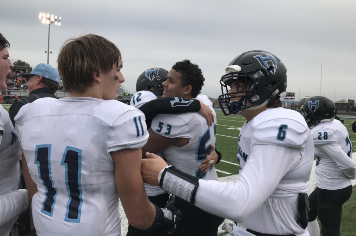 The Hockinson Hawks, including Kordell Johnson (53) and Canon Racanelli celebrate the team's 53-30 victory Saturday over West Valley of Spokane.