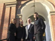This Nov. 21, 2017, photo provided by the Climate Direct Action group shows Leonard Higgins, second from right, with his defense attorneys outside the Choteau County Courthouse in Fort Benton, Mont. Higgins was convicted Wednesday, Nov. 22, on charges of of criminal mischief and trespassing after he entered a fenced site near Big Sandy, Mont., in October 2016 and closed a valve on a pipeline carrying crude oil from Canada to the United States to call attention to climate change. With Higgins are attorney Lauren Regan, left; attorney Kelsey Skaggs, second from left, and attorney Herman Watson.