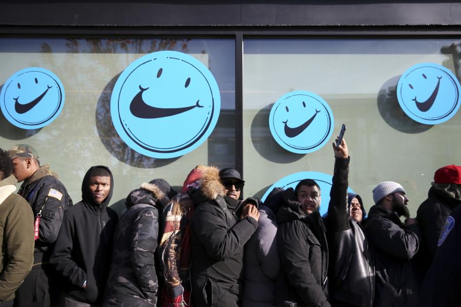 a7e0ac35e2f People who had wristbands to enter wait outside Need Supply Co.