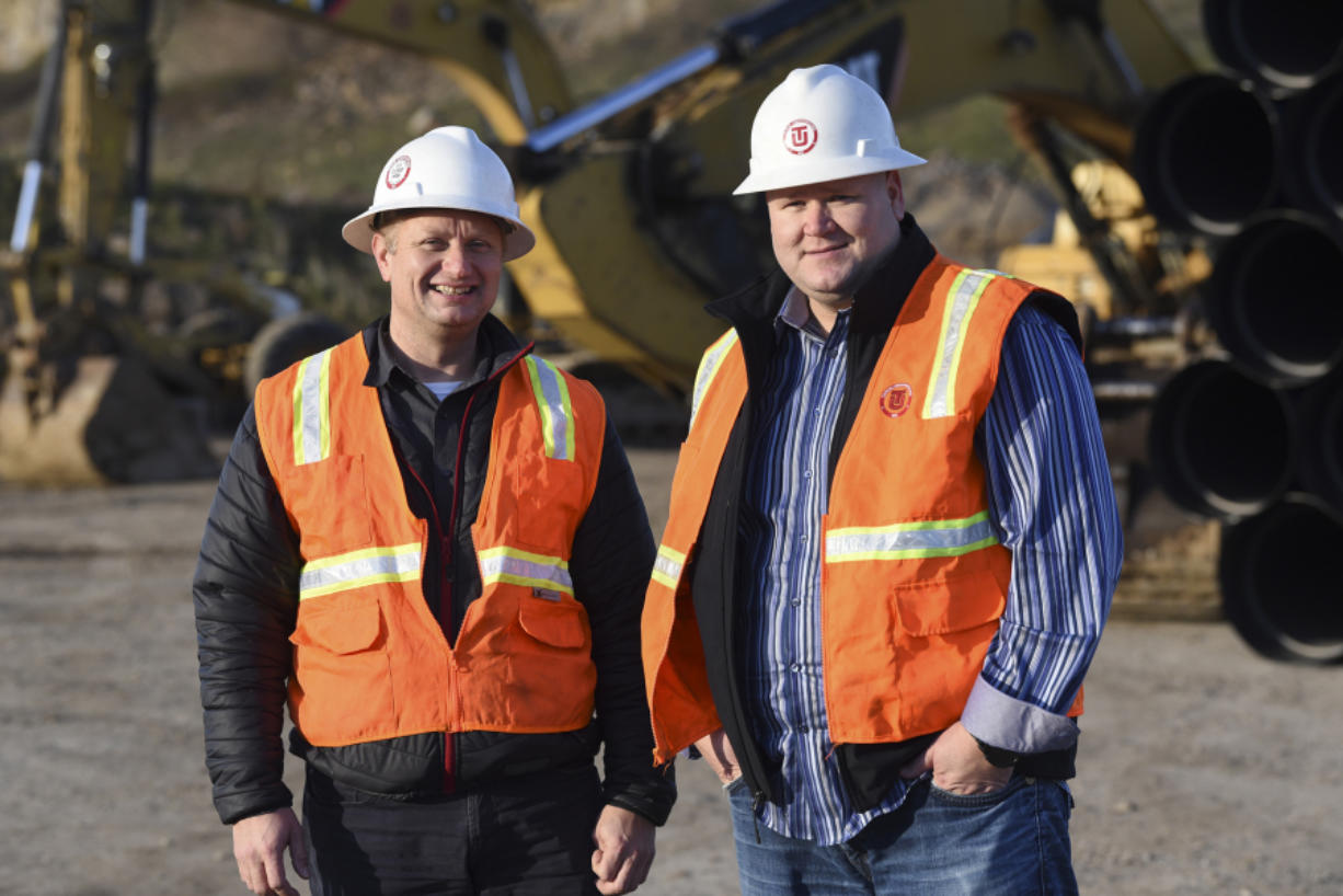 Kevin Tapani, left, and Leigh Tapani are pictured at the construction site for the Columbia Palisades in southeast Vancouver. The brothers are two of six family owners of Tapani Inc., which is coming off a record year for revenue in 2017.