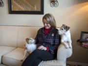 Dawn Horner sits for a portrait in November with her Jack Russell terriers, Mollie and Cooper, at her Vancouver home. Horner was diagnosed with Stage 4 lung cancer in 2014. She has never smoked — though most everyone assumes she must have — and she is now dedicated to educating people about lung cancer.