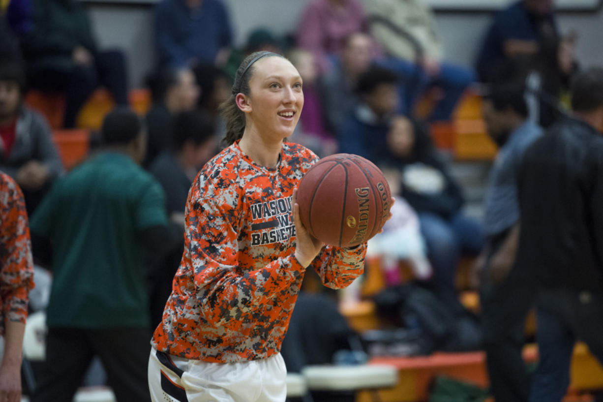 Washougal's Beyonce Bea warms up before the first game of the season against Evergreen High School at Washougal High School, Monday November 27, 2017. (Ariane Kunze/The Columbian)