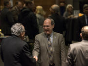 Vancouver City Councilor Jack Burkman speaks with guests during a reception at City Hall.