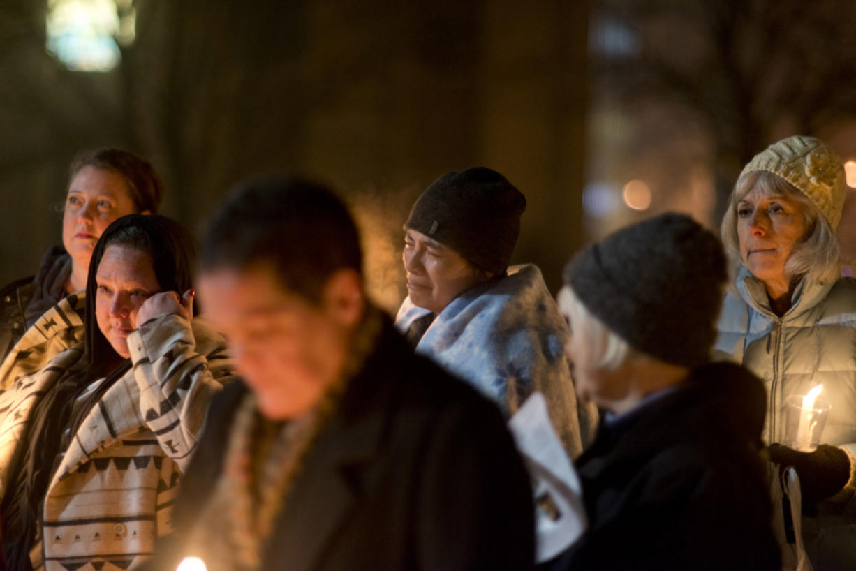 Deanna Huynh, center, of Vancouver, reacts when the name of her friend, Matt Solop, is read. Solop was one of 17 homeless people who died in Clark County in the past year.